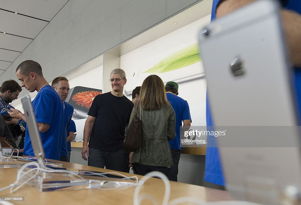 Tim Cook, chief executive officer of Apple Inc., walks through the Apple Inc. store during the sales launch for the iPhone 6 and iPhone 6 Plus in Palo Alto, California, U.S., on Friday, Sept. 19, 2014. Apple Inc.'s stores attracted long lines of shoppers for the debut of the latest iPhones, indicating healthy demand for the bigger-screen smartphones. The larger iPhone 6 Plus is already selling out at some stores across the U.S. Photographer: David Paul Morris/Bloomberg via Getty Images