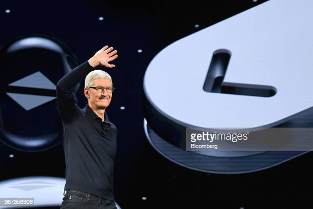 Tim Cook chief executive officer of Apple Inc waves while arriving on stage during the Apple Worldwide Developers Conference in San Jose California...