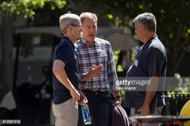 Tim Cook, chief executive officer of Apple, Jeff Bewkes, chief executive officer of Time Warner, and Eddy Cue, senior vice president of internet...