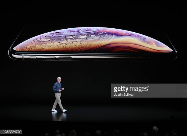 Tim Cook chief executive officer of Apple speaks during an Apple event at the Steve Jobs Theater at Apple Park on September 12 2018 in Cupertino...