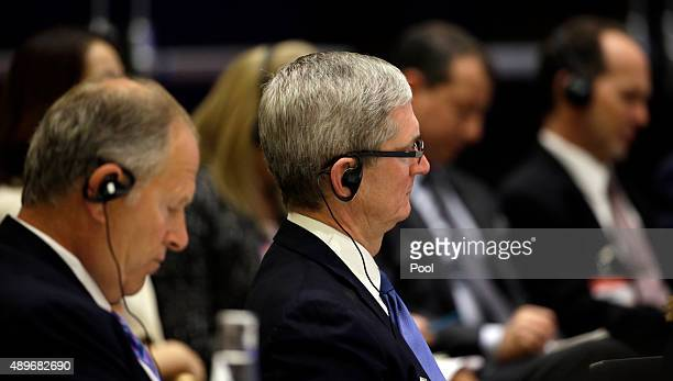 Tim Cook of Apple and David Cote, of Honeywell listen as Chinese President Xi Jinping speaks at a U.S.-China business roundtable, comprised of U.S....