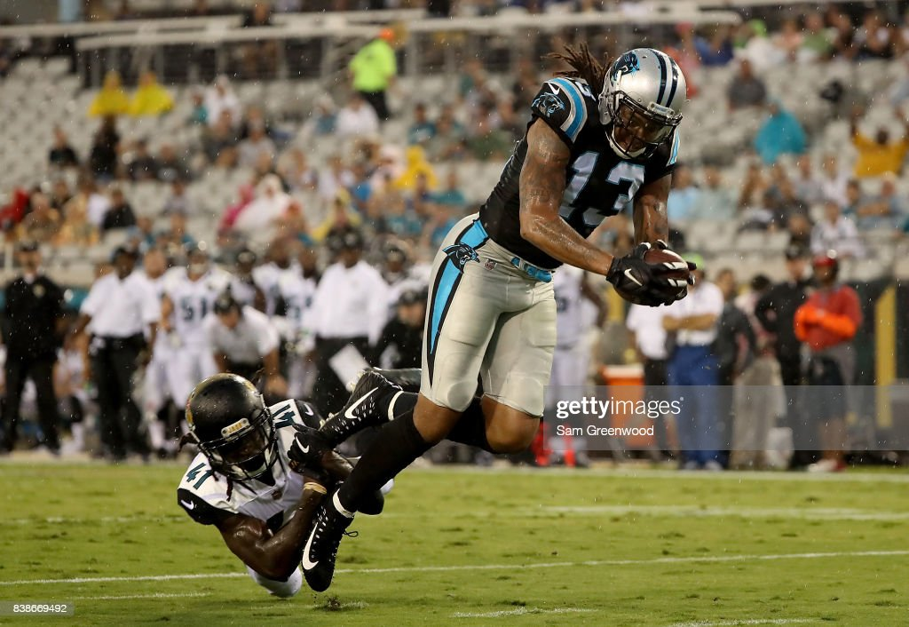 Tim Cook #41 of the Jacksonville Jaguars attempts to tackle Kelvin Benjamin #13 of the Carolina Panthers during a preseason game at EverBank Field on August 24, 2017 in Jacksonville, Florida.