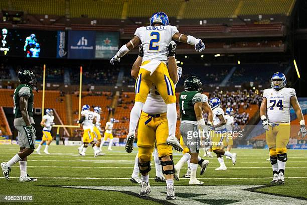 Tim Crawley of the San Jose State Spartans and teammates celebrate his touchdown against the Hawaii Warriors during the first quarter of a college...