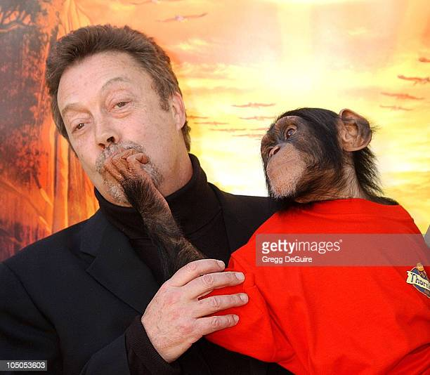 Tim Curry Jake the Monkey during The Wild Thornberrys Movie Premiere at Cinerama Dome in Hollywood California United States