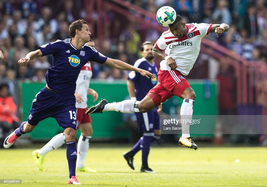 Tim Danneberg of Osnabrueck challenges Bobby Wood of Hamburg during the DFB Cup match between VfL Osnabrueck and Hamburger SV at Osnatel Arena on August 13, 2017 in Osnabrueck, Germany.