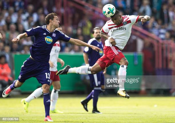 Tim Danneberg of Osnabrueck challenges Bobby Wood of Hamburg during the DFB Cup match between VfL Osnabrueck and Hamburger SV at Osnatel Arena on...