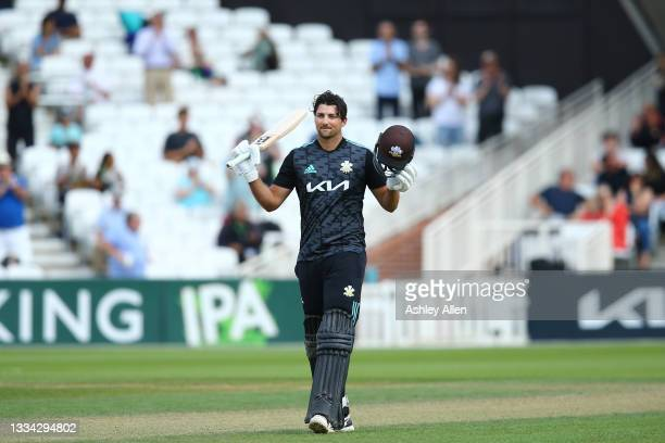 Tim David of Surrey reaches 100 during the Royal London Cup Quarter Final match between Surrey and Gloucestershire at the Kia Oval on August 15,...