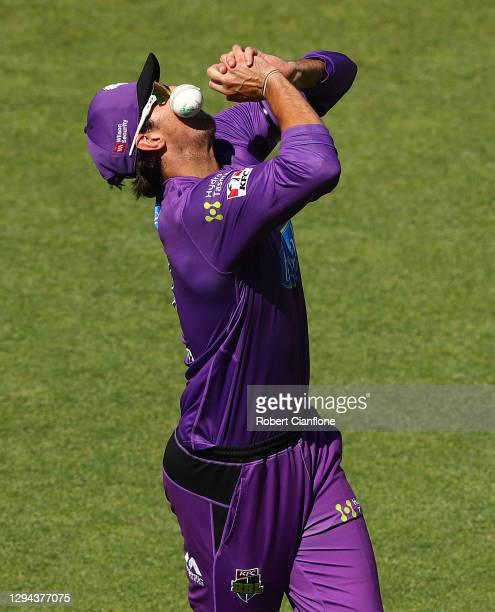 Tim David of the Hurricanes juggles the ball as he takes a catch to dismiss Nick Larkin of the Melbourne Stars during the Big Bash League match...