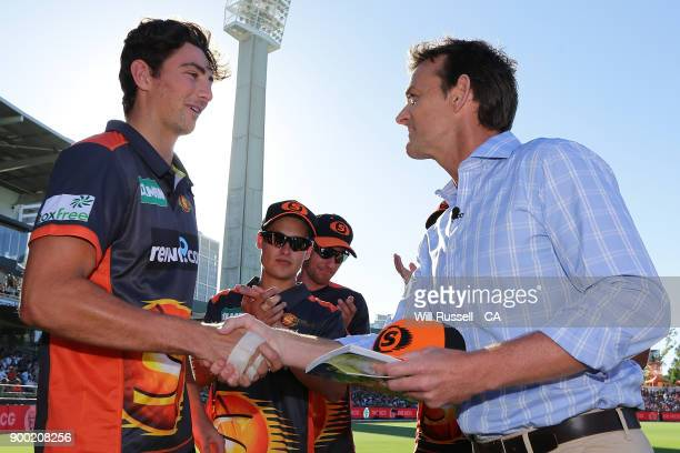Tim David of the Scorchers is presented with his cap by Adam Gilchrist during the Big Bash League match between the Perth Scorchers and the Sydney...