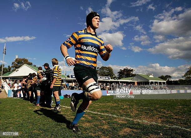 Tim Davidson of Sydney University runs out onto the field before the round 19 Shute Shield match between Eastwood and Sydney University held at TG...