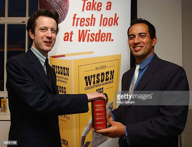 Tim De Lisle editor of the 140th edition of the Wisden Cricketers' Almanac presents England Cricketer Adam Hollioake with a special copy of the...