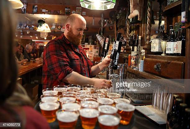 Tim Decker pours samples of Lagunitas Brewing Company beers during a brewery tour at Lagunitas Brewing Company on February 21 2014 in Petaluma...