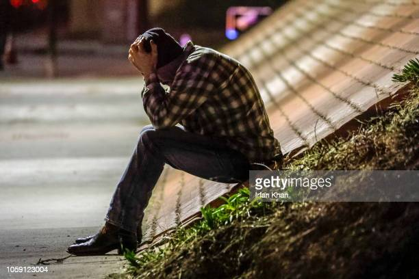 Tim Dominguez who was in the bar with his son distraught over the shooting sits under the freeway after a gunman opened fire late Wednesday at a...