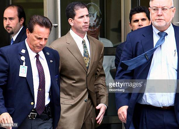 Tim Donaghy, a former referee for the National Basketball Association , center, leaves Federal District Court after his sentencing in the Brooklyn...