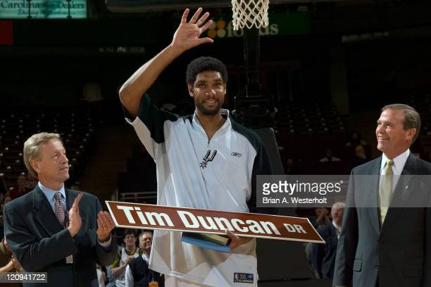 Tim Duncan acknowledges the crowd after Winston-Salem mayor Allen Joines and Wake Forest Athletic Director Ron Wellman presented him with a street...