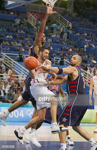 Tim Duncan and Carlos Boozer of United States put the pressure on Juan Carlos Navarro of Spain in the men's basketball quarterfinal game on August 26...