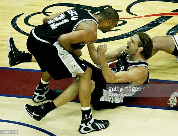 Tim Duncan and Fabricio Oberta of the San Antonio Spurs shout at each other after a threepoint play against the Cleveland Cavaliers in Game Four of...