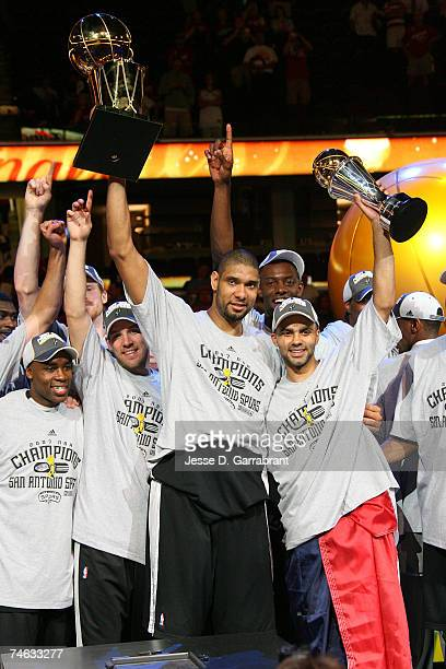 Tim Duncan and Finals MVP Tony Parker of the San Antonio Spurs celebrate with the Larry O'Brien Trophy and MVP Trophy after they won the NBA...
