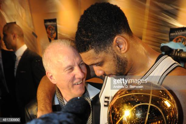 Tim Duncan and Head Coach Gregg Popovich of the San Antonio Spurs celebrates after winning the NBA Championship against the Miami Heat during Game...