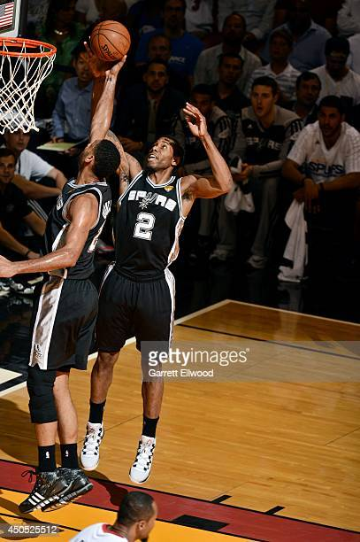 Tim Duncan and Kawhi Leonard of the San Antonio Spurs jump for a rebound against the Miami Heat in Game Four of the 2014 NBA Finals at American...