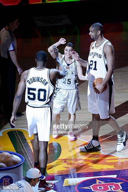 Tim Duncan Becky Hammon and David Robinson of Team San Antonio congratulate each other during the Haier Shooting Stars competition as part of 2009...