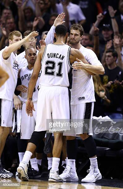 Tim Duncan celebrates with Tiago Splitter of the San Antonio Spurs on the bench against the Miami Heat during Game Five of the 2014 NBA Finals at the...