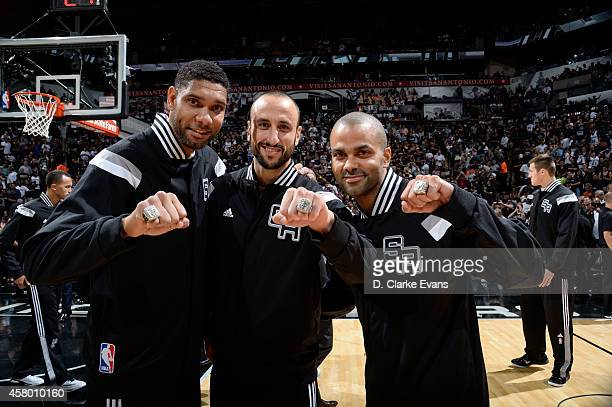 Tim Duncan Manu Ginobili and Tony Parker of the San Antonio Spurs receive Championship Rings prior to the game against the Dallas Mavericks at the...