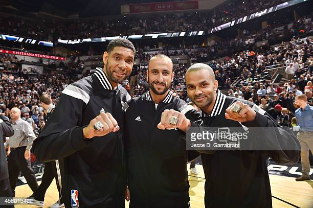 Tim Duncan Marco Belinelli and Tony Parker of the San Antonio Spurs present their championship rings before the game against Dallas Mavericks on...