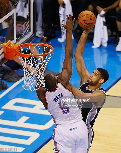 Tim Duncan of of the San Antonio Spurs shoots over Serge Ibaka of the Oklahoma City Thunder in the second half during Game Six of the Western...