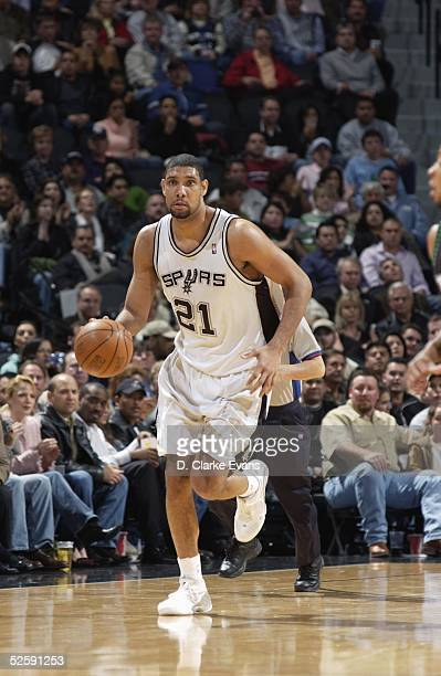 Tim Duncan of the San Antonio Spurs advances the ball upcourt during the NBA game against the Minnesota Timberwolves at the SBC Center on March 16...