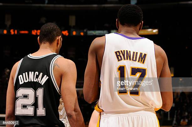Tim Duncan of the San Antonio Spurs and Andrew Bynum of the Los Angeles Lakers stand next to each other during their game at Staples Center on...