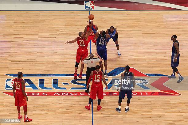 Tim Duncan of the San Antonio Spurs and the Western Conference and Dwight Howard of the Orlando Magic and the Eastern Conference go after the opening...