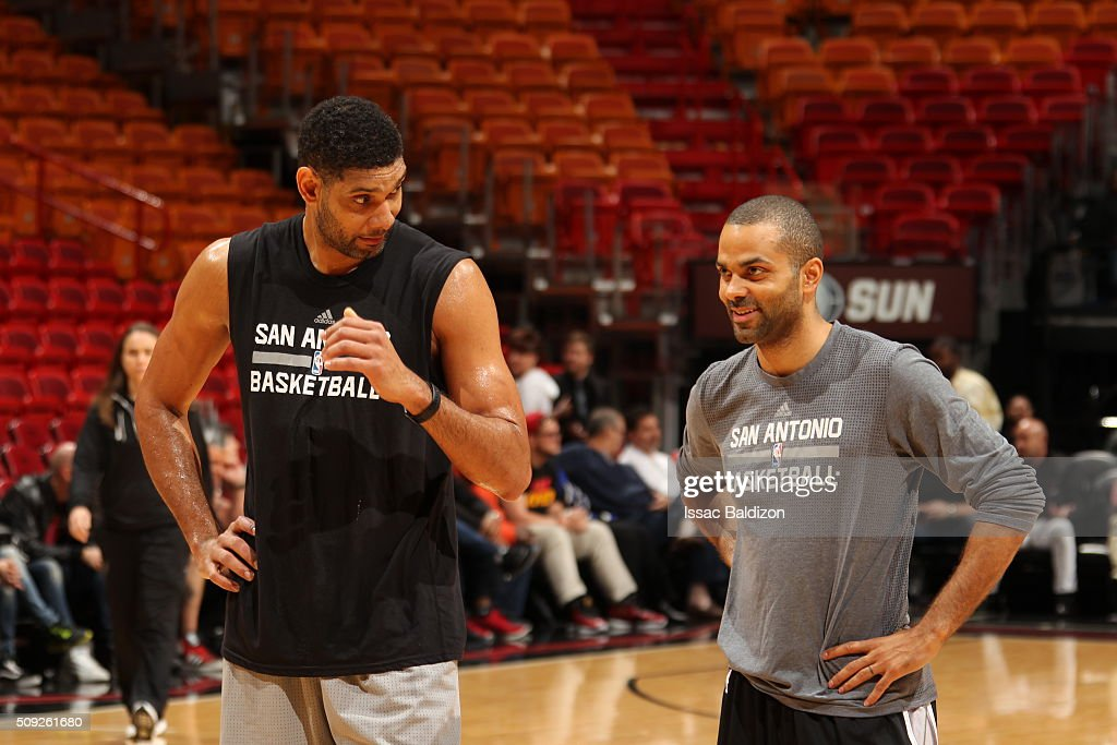 Tim Duncan #21 of the San Antonio Spurs and Tony Parker #9 of the San Antonio Spurs talk before the game against the Miami Heat on February 9, 2016 at American Airlines Arena in Miami, Florida.
