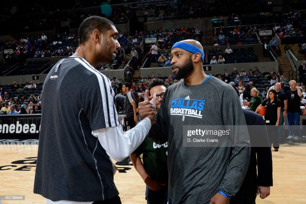 Tim Duncan #21 of the San Antonio Spurs and Vince Carter #25 of the Dallas Mavericks shake hands before the game on March 14, 2013 at the AT&T Center in San Antonio, Texas.