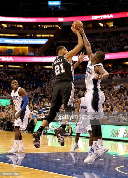 Tim Duncan of the San Antonio Spurs attempts a shot over Andrew Nicholson of the Orlando Magic during the game at Amway Center on February 10 2016 in...