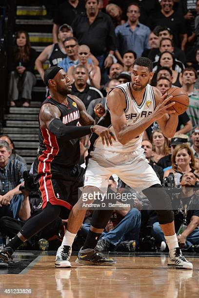 Tim Duncan of the San Antonio Spurs backs up to the basket against the Miami Heat during Game Five of the 2014 NBA Finals between the Miami Heat and...