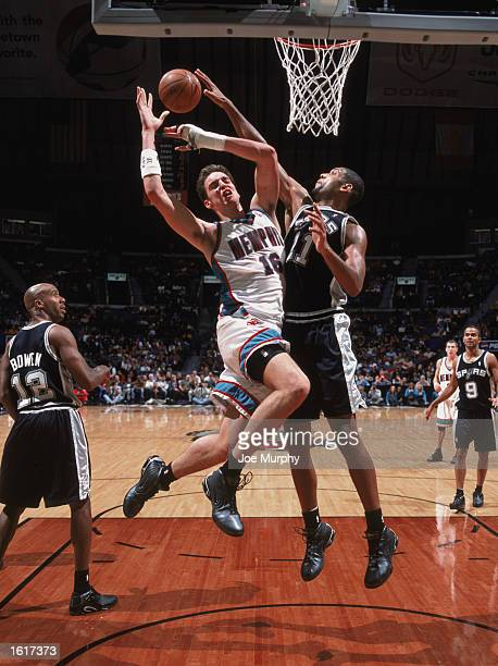 Tim Duncan of the San Antonio Spurs blocks the shot by Pau Gasol of the Memphis Grizzlies during the NBA game at The Pyramid on November 4 2002 in...