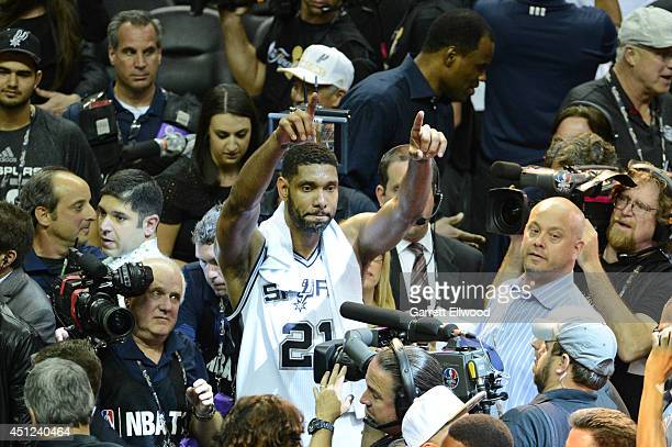 Tim Duncan of the San Antonio Spurs celebrates after the big Win against the Miami Heat during Game Five of the 2014 NBA Finals between the Miami...
