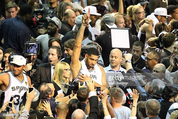 Tim Duncan of the San Antonio Spurs celebrates winning the the Larry O'Brien Trophy after Game Five of the 2014 NBA Finals against the Miami Heat at...