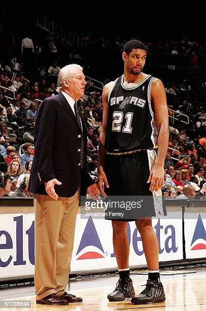 Tim Duncan of the San Antonio Spurs chats with head coach Gregg Popovich during the Atlanta Hawks v San Antonio Spurs game on November 13 2004 at...