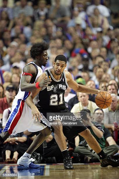 Tim Duncan of the San Antonio Spurs drives against Ben Wallace of the Detroit Pistons in Game three of the 2005 NBA Finals June 14 2005 at the Palace...