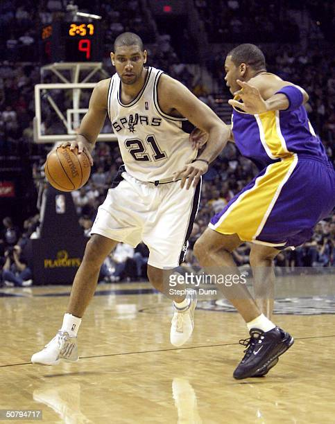 Tim Duncan of the San Antonio Spurs drives against Devean George of the Los Angeles Lakers during Game one of the Western Conference Semifinals...