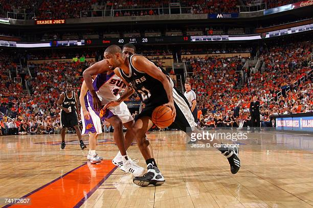 Tim Duncan of the San Antonio Spurs drives against Kurt Thomas of the Phoenix Suns in Game Five of the Western Conference Semifinals during the 2007...