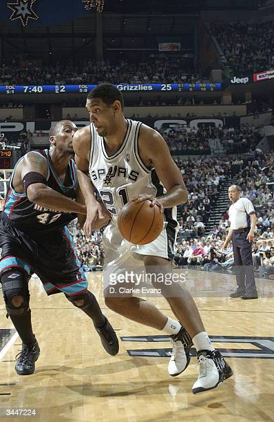 Tim Duncan of the San Antonio Spurs drives against Lorenzen Wright of the Memphis Grizzlies during game two round one of the NBA Playoffs on April 19...