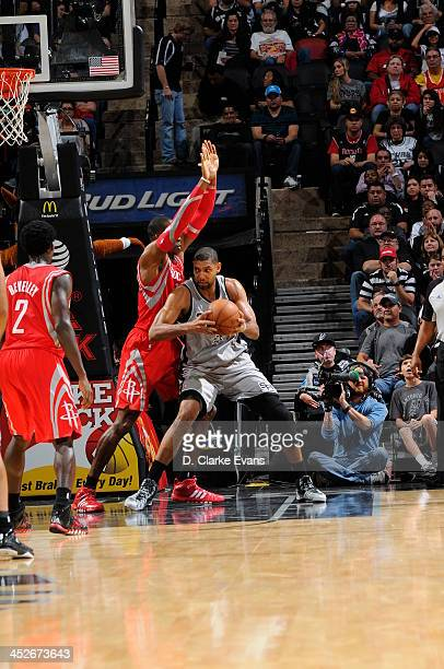 Tim Duncan of the San Antonio Spurs drives against the Houston Rockets at the ATT Center on November 30 2013 in San Antonio Texas NOTE TO USER User...