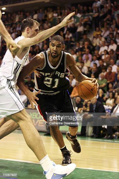 Tim Duncan of the San Antonio Spurs drives by a defender during the preseason game against Adecco ASVEL Lyon-Villeurbanne during the NBA Europe Live...