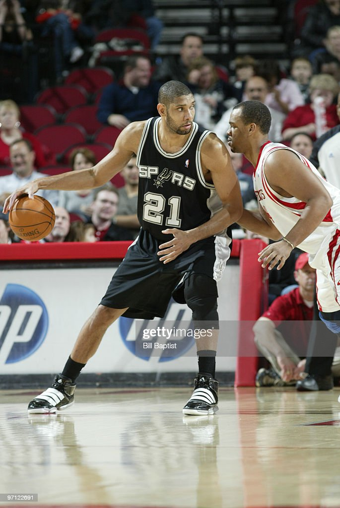 Tim Duncan #21 of the San Antonio Spurs drives the ball past Chuck Hayes #44 of the Houston Rockets on February 26, 2010 at the Toyota Center in Houston, Texas.