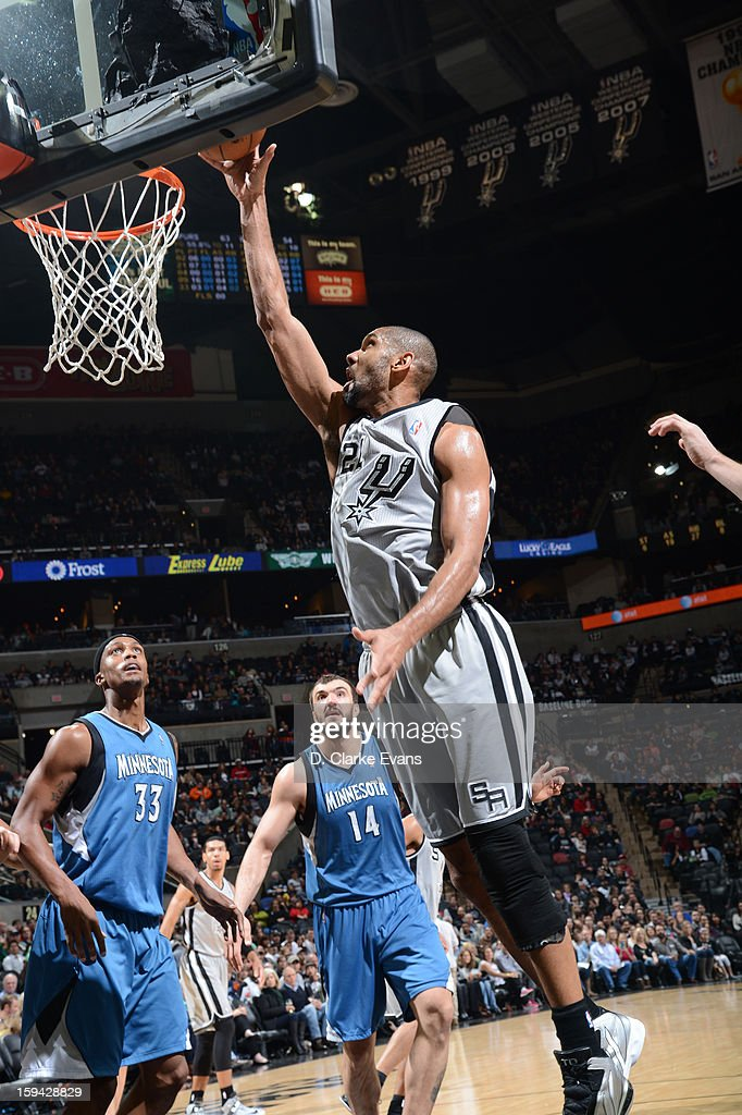Tim Duncan #21 of the San Antonio Spurs drives to the basket against the Minnesota Timberwolves on January 13, 2013 at the AT&T Center in San Antonio, Texas.