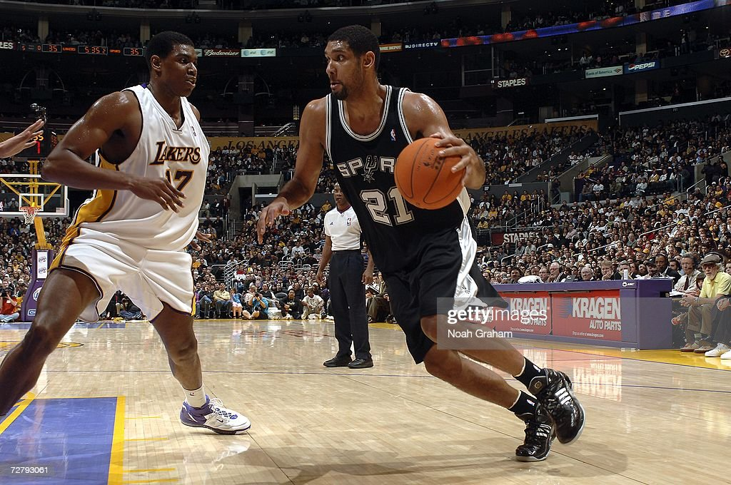 Tim Duncan #21 of the San Antonio Spurs drives to the hoop against Andrew Bynum #17 of the Los Angeles Lakers on December 10, 2006 at Staples Center in Los Angeles, California.