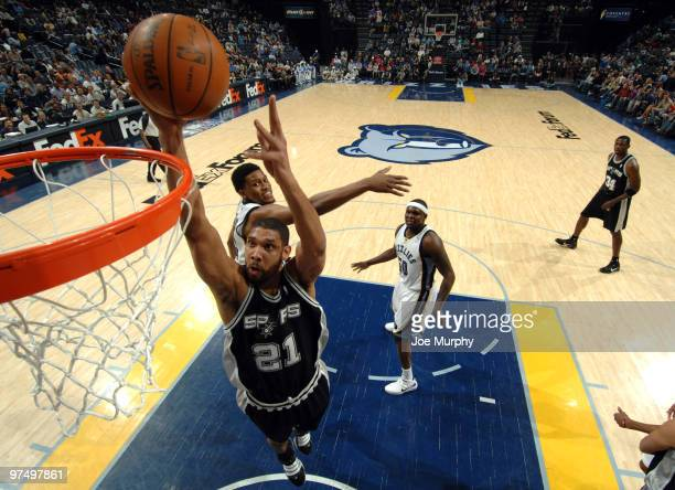 Tim Duncan of the San Antonio Spurs dunks against Rudy Gay of the Memphis Grizzlies on March 6 2010 at FedExForum in Memphis Tennessee NOTE TO USER...